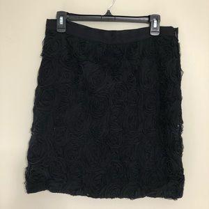 Black pencil skirt with florets.